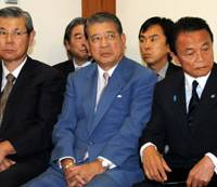 Counted out: Defeated Prime Minister Taro Aso (right) sits glumly with fellow Liberal Democratic Party bigwigs the day after their party's hiding in the Aug. 30 Lower House elections. | SATOKO KAWSAKI PHOTO