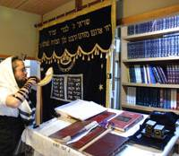 Robbi Binyomin Edery blows the shofar, atraditional ram's horn for the Jewish New Year, at Chabad House in Tokyo. | DANIEL ROBSON PHOTO
