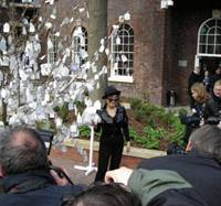 Yoko Ono poses next to the 'Wish tree,' one of her art installations at the Bluecoat Arts Center in Liverpool in 2008. | KARLA MERRIFIELD / CHARLOTTE KEMP MUHL AND SEAN LENNON