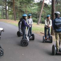 Trail blazers: Segway tour participants at Musashi Kyuryo National Park in Saitama Prefecture (otherwise known as Shinrin Koen), stop along the way to listen to their Segway-mounted guide explain interesting details about the park's flora and fauna. | EDAN CORKILL