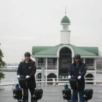 Riding high: Security guards on Segways at Pacifico Yokohama convention center, where the machines are standard issue. | PACIFICO YOKOHAMA