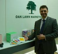 Operators are standing by: Harry Hill, president of Oak Lawn Marketing Inc., shows off some of the products available on his TV shopping channels at his company's office in Minato Ward, Tokyo. | MINORU MATSUTANI PHOTO