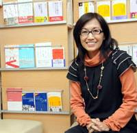Prolific: Rika Kayama in her office in Harajuku, Tokyo, with some of the 90 books she has written about mental illnesses, social issues and culture.   SATOKO KAWASAKI PHOTO