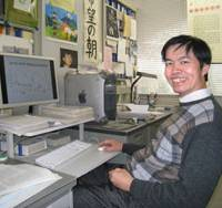 Crunching numbers: Nuclear physicist Nguyen Dinh Dang works in his office at the Riken science institute in Wako, Saitama Prefecture. | EDAN CORKILL PHOTO