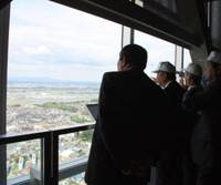 Eye-opening: Some of the first visitors to the 'G1 Tower' since it was completed in April take in the view this month from its observation floor 180 meters up. | TOMOKO OTAKE PHOTO