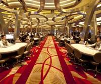 Place your bets: Five years after Singapore legalized casinos, Marina Bay Sands — its second facility combining gambling, convention, retail and entertainment functions — opened last month and offers a model that may soon be applied to Japan. | MARINA BAY SANDS