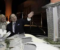 High rollers: Las Vegas Sands Corp. Chairman Sheldon Adelson and his wife, Miriam, with a model of the company's Marina Bay Sands in Singapore. | MARINA BAY SANDS