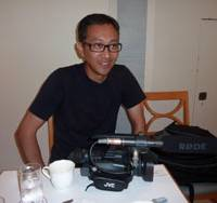 Tools of the trade: Paul del Rosario shows the video camera he uses for his English-language lessons. | MAMI MARUKO PHOTO