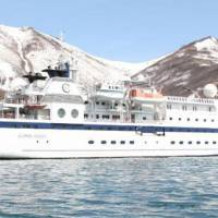 Home from home: Our Clipper Odyssey off Cape Kekyryni on the Kamchatka Peninsula. | MARK BRAZIL PHOTOS
