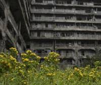 Lives gone by: Apartment blocks on 'Warship Island' off Nagasaki, a former coal- mining hub that was home to 5,300 people until it shut down in 1974. | JUN NAKASUJI PHOTO