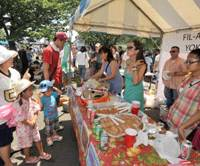 Families gather around one of the food stands at the Navy Friendship Day festival Saturday at the U.S. Navy base in Yokosuka. | YOSHIAKI MIURA PHOTO