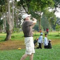Bob White plays at the 4th hole on the KM6 Golf Course near Vientiane in Laos. | COURTESY OF BOB WHITE