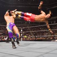 Eat feet!: Japanese 'superstar' RAW wrestler Yoshi Tatsu has won many fans in the United States for athletic maneuvers like this high-flying drop- kick on American Zack Ryder during a bout in Phoenix, Arizona in 2009. | © WORLD WRESTLING ENTERTAINMENT INC. ALL RIGHTS RESERVED.