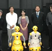 Dream team: Key to the Robot- Human Theater project's 2008 pioneer staging were (left to right): Playwright Oriza Hirata, actors Hiroshi Ota and Minako Inoue, Eager Co. Ltd. President Kazunari Kuroki, robot expert Hiroshi Ishiguro . . . and robot actors Takeo and Momoko. | © OSAKA UNIVERSITY & EAGER Co. Ltd.