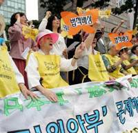 Fighting on: Former Korean 'comfort women' forced to serve the Japanese military during World War II protest in Seoul in 2007, demanding compensation from Japan. | AP PHOTO