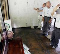 Doing penance: Japanese scholars visiting Namyangju in northern South Korea in July 2007 pay their respects and apologize for the past at the tomb of Empress Myeongseong. Queen Min, as she is known, was assassinated by Japanese zealots in 1895.   KYODO PHOTO