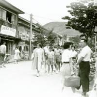 Memory lane: The main street in Karuizawa, Nagano Prefecture, in 1952. The office of The Japan Times, from where  all the town's high-society gossip and action from the tennis courts was reported, is on the left with a telegraph pole in front.   YSUCHIYA SHASHINKAN PHOTO