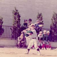 Young blood: Kuwata at the batter's box during his second grade at elementary school — when he says he was already competing with sixth-graders. | COURTESY OF MASUMI KUWATA