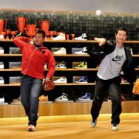 Double vision: Kuwata (right) and Boston Red Sox pitcher Daisuke Matsuzaka throw balls in an event to launch a Nike store in Tokyo's Harajuku district in 2009. | YOSHIAKI MIURA PHOTO
