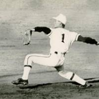 Powering up: Kuwata seen pitching during his junior high school days. He says his baseball skills improved significantly around that time, although he was often bullied by senior teammates for outperforming them. | COURTESY OF MASUMI KUWATA