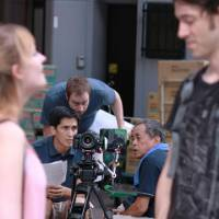 Straight to Web: Anthony Gilmore (holding papers) directs the crew during the filming of 'English Teachers' in Nagoya.