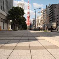 Wide open space: No benches to be found on these wide footpaths in Tokyo's Mita district (above) or Yurakucho. | CHRIS MACKENZIE