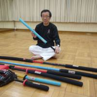 Tetsundo Tanabe, sport chanbara's creator, displays the weapons players can use during competition.   TOMOKO OTAKE PHOTO