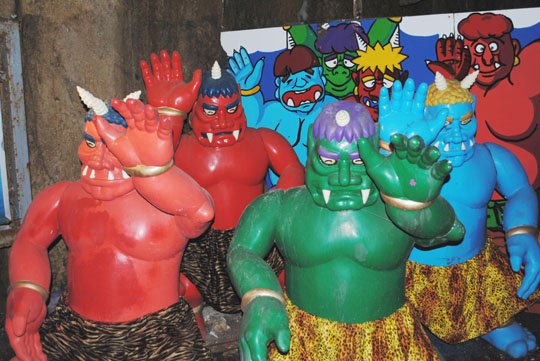 Demons wave goodbye to tourists as they leave the demon's cave on Megijima in the Seto Inland Sea.   AMY CHAVEZ