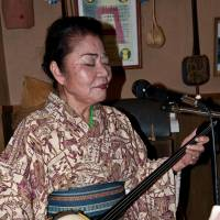 Oshiro sings an Okinawan folk song. | STEPHEN MANSFIELD