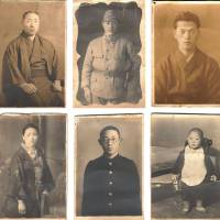 Memories of home: These photos were found by reader TT's grandfather in a canister carried by an Imperial Japanese Army soldier who was killed in a gunbattle with U.S. forces in mountains near the Philippine capital, Manila, in 1944. TT would like to return the sword and these pictures to the late Japanese soldier's family.