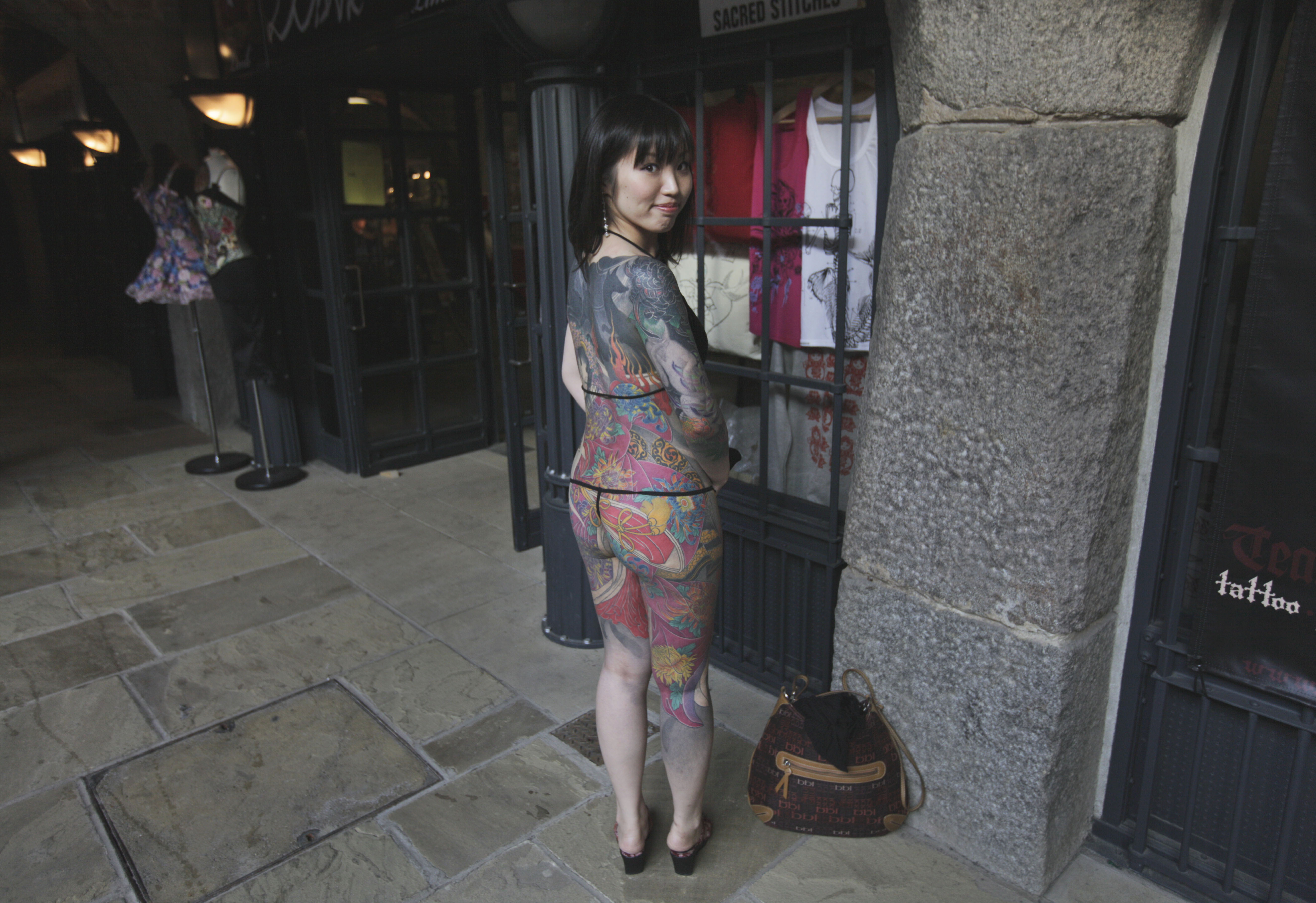 The full monty: Osakan Rie Gomita could have trouble landing an ALT job in Japan with this irezumi ensemble.   AP