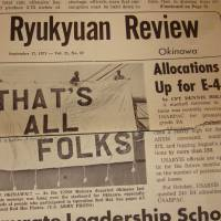 Don't all laugh at once: A banner emblazoned with the 'Loony Tunes' catchphrase 'That's All Folks!' that American servicemen hung over the stern of the USNS McGraw on Sept. 10, 1971, as it left Ten Gan Pier with the final load of toxic munitions to be removed from Okinawa for disposal under Operation Red Hat.   TIM GRAVELY