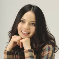 Glass half full: Japanese TV shows are full of cute 'half' young adults like Becky, but being a bit different isn't necessarily always a barrel of laughs in Japan.   KYODO
