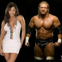 WWE wrestlers Candice Michelle and Triple H | (C) 2008 WORLD WRESTLING ENTERTAINMENT, INC. ALL RIGHTS RESERVED.