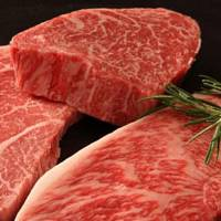 Sirloin steaks from Nakanishi's farm show the fat-marbling that Kobe beef is famous. | YOSHIMITSU SOTOIKE PHOTO