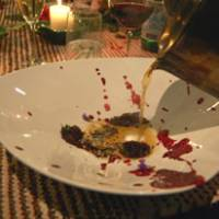 Illustrated food chain: For September's Cook it Raw event in Lapland, Finland, Yoshihiro Narisawa created a bear, grouse and rabbit consomme, which he poured over strips of wild hare served with a sauce of lingonberry and blueberry. | MELINDA JOE PHOTO