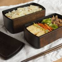 Hibiju wooden bento¯  lunch boxes, designed by Masanori Oji and crafted by Wajima Kirimoto, are lacquered on the inside and have a natural finish on the outside.