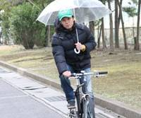 Talking on a cell phone or carrying an umbrella while riding a bike will be targeted in Japan's first revision of cycling laws in nearly 30 years.   MINA USHIDA PHOTOS