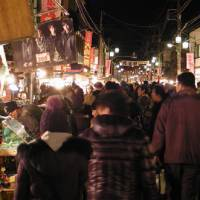 Roll up, roll up: Crowds promenade between the lines of around 750 stalls at the annual Boroichi market   MARK SCHREIBER PHOTO