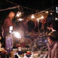 Take your pick: One of the market's many bric-a-brac stalls | MARK SCHREIBER PHOTO
