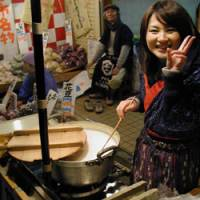 Vendors sell cups of hot, sweet amazake | MARK SCHREIBER PHOTO