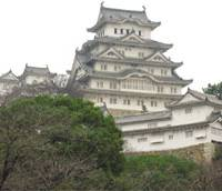Edifying edifice: Himeji Castle in all it's glory (top). above: A castle detail shows eaves on which each tile bears a crest of a lord who helped build the fortress. | SIMON BARTZ
