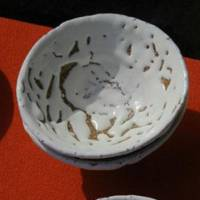 A bowl shows Hagi ware's typical milky-white color and unglazed patches.