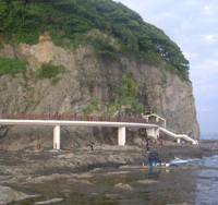 Shore line: The footbridge to Enoshima Island's rocky shore that first passes the mouth of the 152-meter-long Dragon Cave, then a second, 'funhouse' cave with a Day-Glo dragon and thunder and lightning effects.