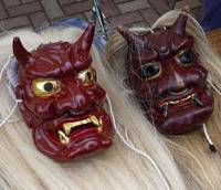 A pair of goblin masks wait for their cue to take part in the Onidaiko Festival in Ryotsu on May 24, which featured various groups performing their own versions of a local folk myth about supposedly friendly demons, as well as a 'battle of the drums.'