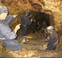 Tunnel vision: Marionettes in the Aikawa gold mine near Mano eerily evoke the dreadful conditions in which, from 1601, workers excavated ore that yielded 78 tons of the precious metal before the mine closed in 1989. | MARK BRAZIL PHOTOS