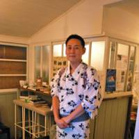 Local faces: Henmi- san  (above), the owner of Suikado Cafe Gallery in Chichibu, which serves up art with its coffees; and a statue of Kannon, the Goddess of Mercy, at Nosakaji Temple near Seibu-Chichibu Station. | MELINDA JOE PHOTOS