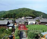 Make-believe: Never lived in, this spotless, picture-perfect village (above) was built as the set for a famed 1954 film, 'Nijushi no Hitomi' ('Twenty-four Eyes'), about a Shodoshima teacher and her students — shown (below) in a mural in the village.