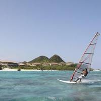 Holiday idyll: Windsurfing is just one of many outdoor and indoor activities available for guests at Club Med Kabira Beach. The resort is seen here (above) on the coast overlooking glistening white beaches. | CLUB MED KABIRA BEACH PHOTOS