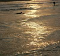 Surf sunset: Two people have the liquid gold of a Kujukuri-hama evening to themselves.